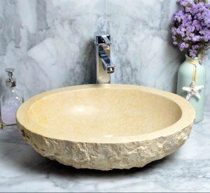 Beige marble round sink