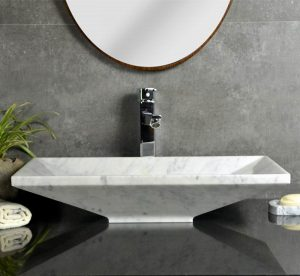 White marble upright sinks by Carrara